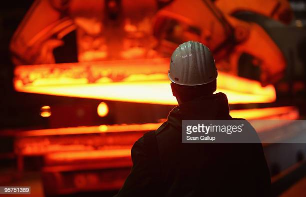 A worker uses a remote control to transport giant blocks of heated steel at the rolling mill at the ThyssenKrupp steelworks on January 13 2010 in...