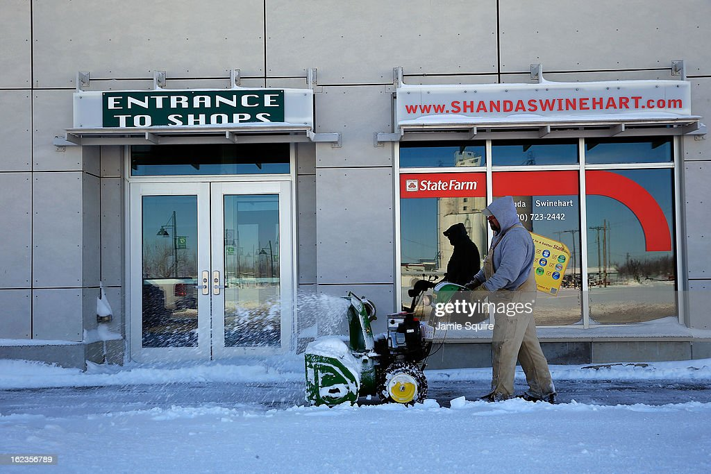 A worker uses a snowblower after a large midwest winter storm on February 22, 2013 in Greensburg, Kansas. The storm dumped at least a foot of snow in Kansas and forcasters say it is headed to the northeast U.S.