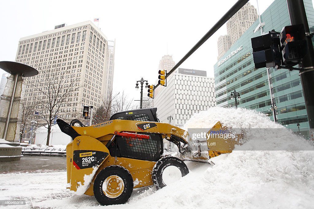 A worker uses a tractor to remove snow along Woodward Avenue as the area deals with record breaking freezing weather January 6, 2014 in Detroit, Michigan. Michigan and most of the Midwest received their first major snow storm of 2014 last week and subzero temperatures are expected most of this week with wind-chill driving temperatures down to 50-70 degrees below zero. A 'polar vortex' weather pattern is bringing some of the coldest weather the U.S. has had in almost 20 years.