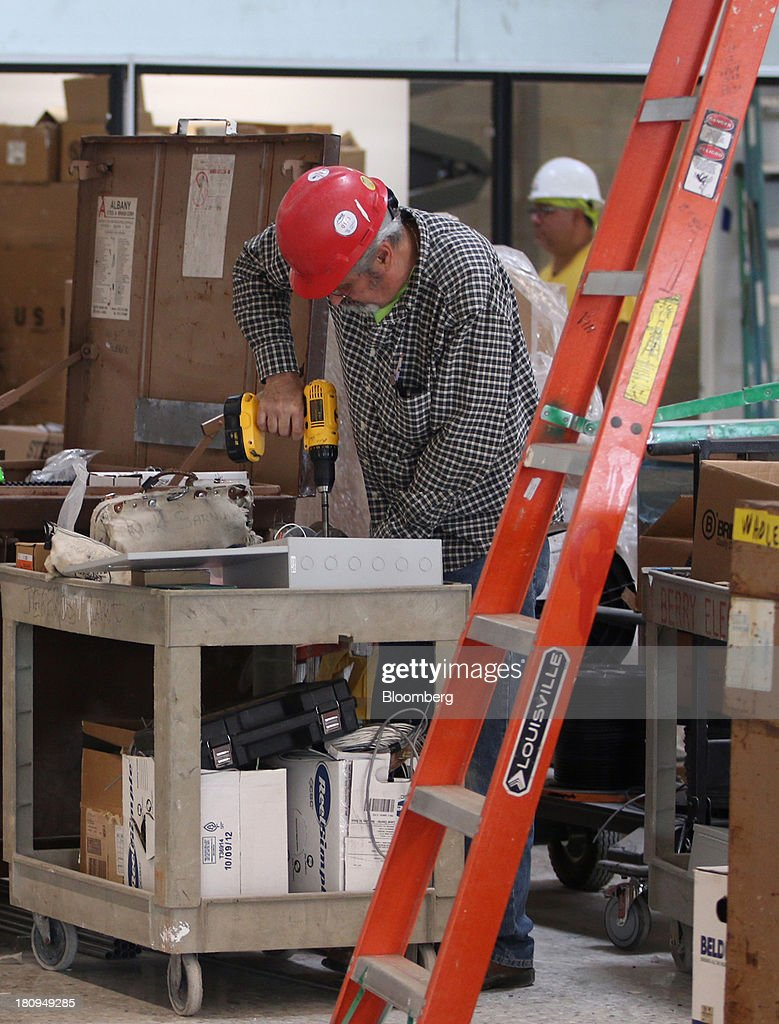 A worker uses an electric drill inside a new Whole Foods Market Inc. store under construction in Park Ridge, Illinois, U.S., on Tuesday, Sept. 17, 2013. Whole Foods is currently scheduled to open eleven new stores in the U.S. and two in the U.K by the fall 2014, according to its website. Photographer: Tim Boyle/Bloomberg via Getty Images