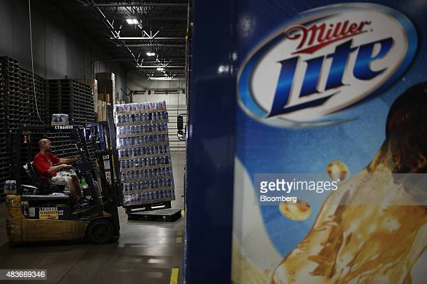 A worker uses forklift to load a delivery truck with MillerCoors LLC brand alcoholic beverages at the Stagnaro Distributing Inc facility in...