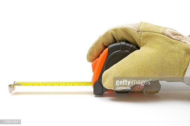 Worker Using a Tape Measure