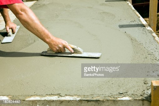 Worker Using Concrete Trowel to Smooth Entrance Step