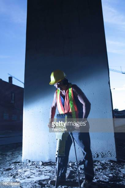 worker using jackhammer