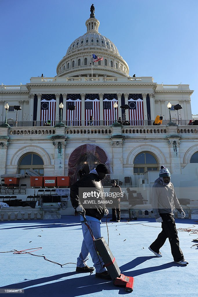 A worker vacuums a platform at the US Capitol as preparations continue for the second inauguration of US President Barack Obama in Washington on January 18, 2013. Crowds may be smaller on the January 21 inauguration than when Barack Obama was first sworn into office in 2009, but security is as tight as ever, with experts warning a 'lone wolf' would pose the greatest threat. Between 500,000 and 800,000 people are expected to pass through the National Mall, the immense greenway that leads up to the Capitol, compared to the 1.8 million spectators who came to applaud Obama four years ago. AFP PHOTO/Jewel Samad