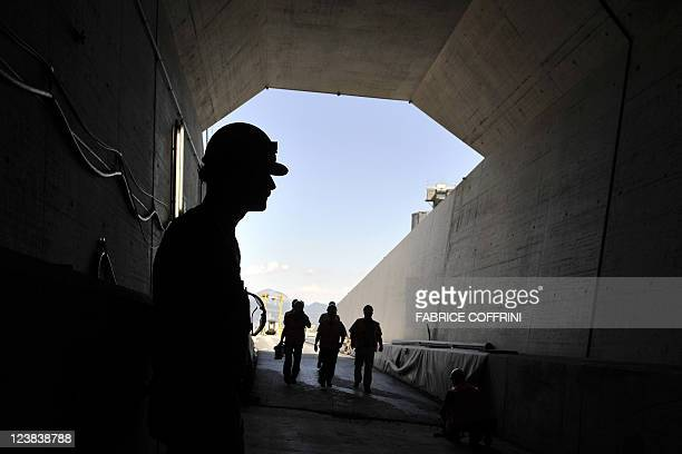 A worker waits for journalists at one of the Gotthard base access tunnels during the launching of the installation of railway equipment on September...