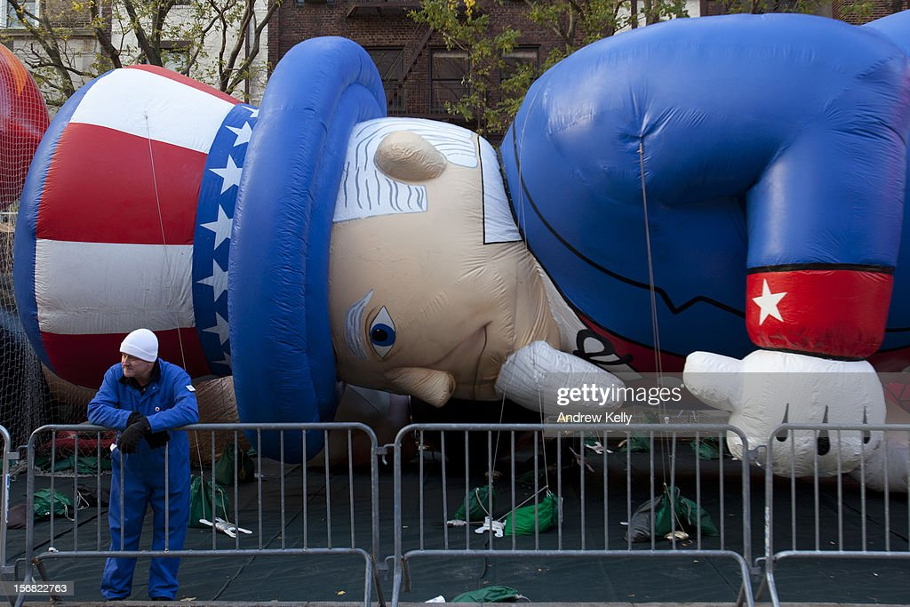 A worker waits with the Uncle Sam balloon before the commencement of the 86th Annual Macy's Thanksgiving Day Parade November 22, 2012 in New York. Macy's donated tickets and transportation to this year's Thanksgiving Day Parade to 5,000 people from neighborhoods hardest hit by Superstorm Sandy.
