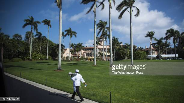 A worker walk along a road at the MaraLago club in West Balm FL on Saturday Dec 17 2016