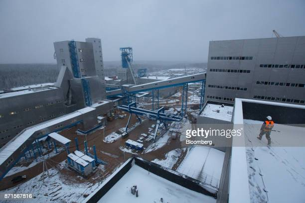 A worker walks across a plant building at the Usolskiy Potash Complex operated by EuroChem Group AG at theVerkhnekamskoe deposit in Perm region...