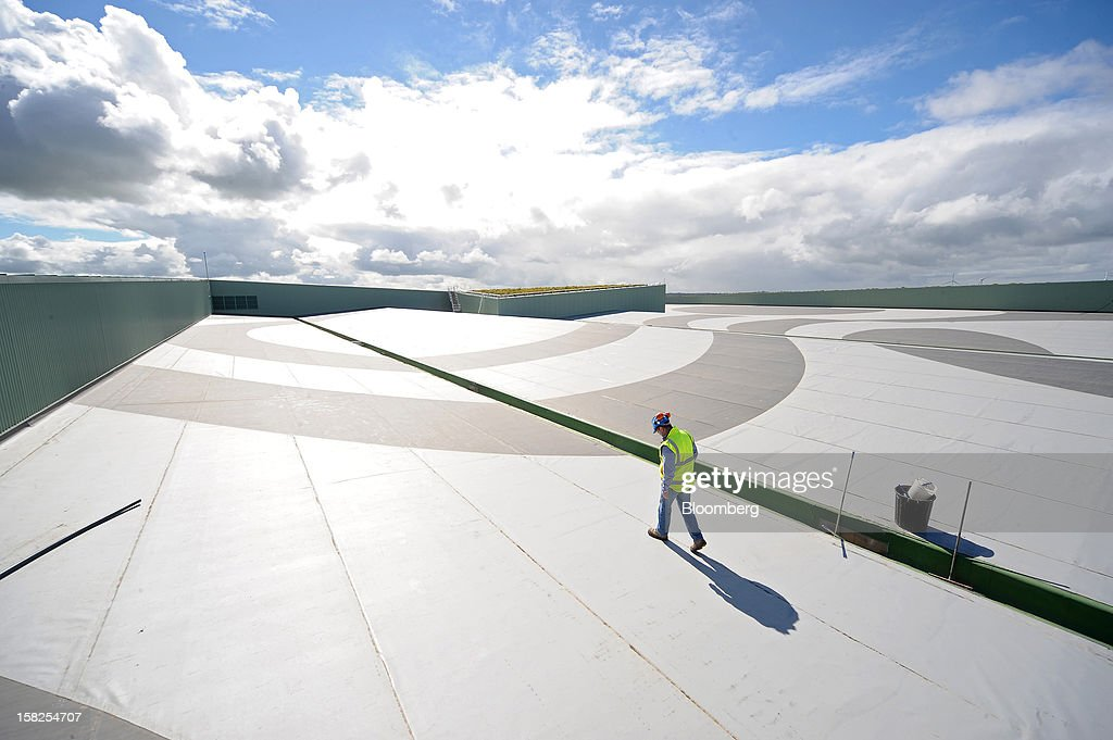 'BEST PHOTOS OF 2012' (): A worker walks across the undulating synthetic covering on the rooftop of the reverse osmosis process building at the Wonthaggi Desalination Plant, built and operated by Suez Environnement SA's Degremont unit and Leighton Holdings Ltd.'s Thiess unit, in Wonthaggi, Australia, on Tuesday, Oct. 9, 2012. The first drinking water from the desalination plant near Melbourne that will be Australia's biggest was produced last month during an initial performance test. Photographer: Carla Gottgens/Bloomberg via Getty Images