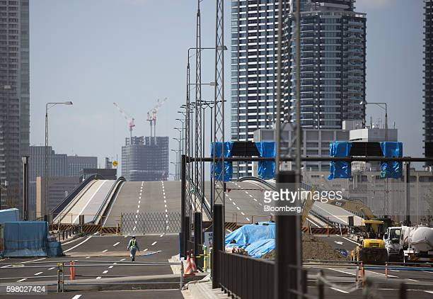 A worker walks along the under construction highway near the Toyosu Market in Tokyo Japan on Wednesday Aug 31 2016 Yuriko Koike governor of Tokyo...