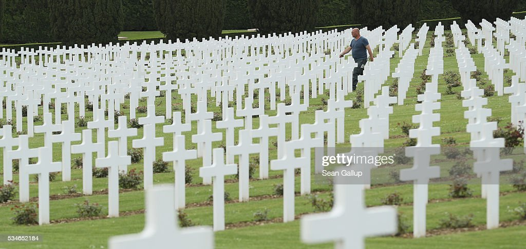 A worker walks among the thousands of crosses marking the graves of French soldiers killed in the Battle of Verdun at the ossuary of Douaumont on May 27, 2016 in Verdun, France. The governments of France and Germany will commemorate the 100th anniversary of the battle with ceremonies this coming Sunday. Approximately 300,000 soldiers lost their lives in the 10-month campaign that was among the most grueling battles of the war.