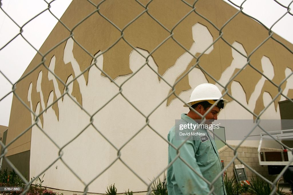 A worker walks by the gymnasium of a school under construction May 17, 2006 in the Los Angeles-area city of Maywood, California. In November, voters, angered that city police were stopping and seizing hundreds of cars whose unlicensed drivers frequently turned out to be illegal immigrants, elected a new majority on the city council. The new council majority promptly voted to eliminate the police department's traffic division, resulting in car impoundments dropping from 240 a month to 40. The city in January also officially opposed a proposed federal law that would have criminalized illegal immigration and forced local police to enforce immigration law. Approximately 96 percent of the city's 29,000 residents is Latino, with an additional 10,000 illegal residents living within city limits, according to estimates.