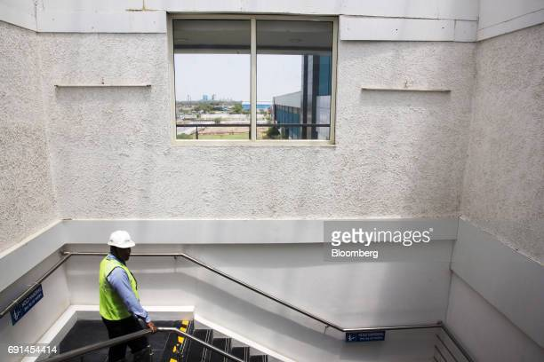 A worker walks down a flight of stairs at an Akzo Nobel India Ltd paint factory in Gwalior Madhya Pradesh India on Thursday June 1 2017 Akzo Nobel NV...
