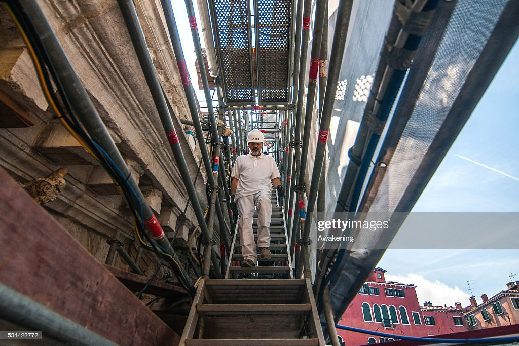 A worker walks down the scaffolding during the renovation of the Rialto Bridge on May 26, 2016 in Venice, Italy. Site visits were organized to see the renovation of the Rialto bridge to coincide with the 15th Biennale of Architecture in Venice.