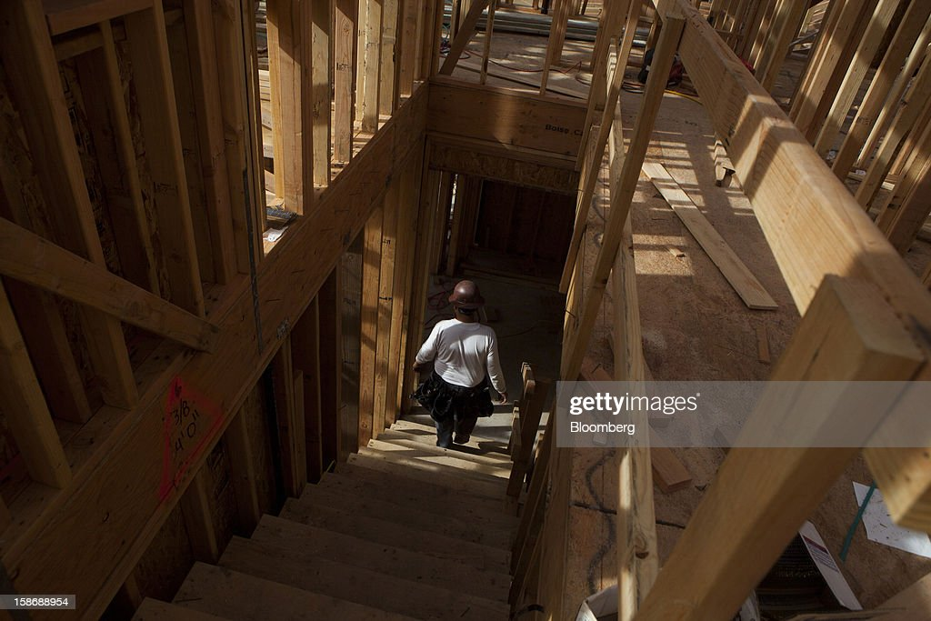 A worker walks down the stairs of a house under construction at Davidson Communities LLC's Arista at The Crosby development in Rancho Santa Fe, California, U.S., on Friday, Dec. 21, 2012. New home sales climbed to a 380,000 annual rate in November, the most since April 2010, according to the median forecast of 60 economists surveyed by Bloomberg before Dec. 27 figures from the Commerce Department. Photographer: Sam Hodgson/Bloomberg via Getty Images