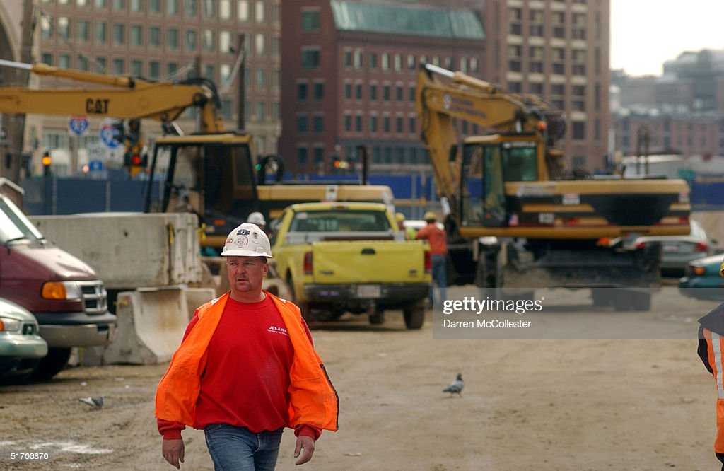A worker walks in a construction site at the 'Big Dig' November 19, 2004 in Boston, Massachusetts. More than 400 leaks have been discovered recently, due to faulty watereproof panels along the Interstate 93 section of the nation's costliest federally funded transportation project. Already at 14.6 billion dollars, Big Dig officials expect the leaks to cost upwards of 10 million more, and years to fix.