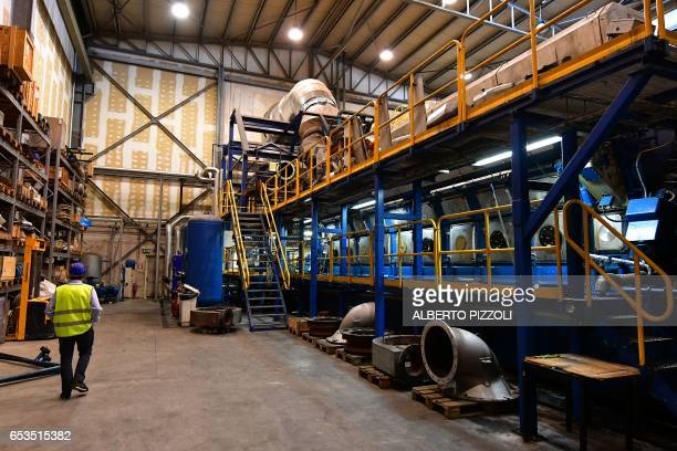 A worker walks in the French sugar cooperative Cristal UnionSFIR Raffineria di Brindisi sugar refinery in Brindisi on March 15 2017 Cristal Union has...