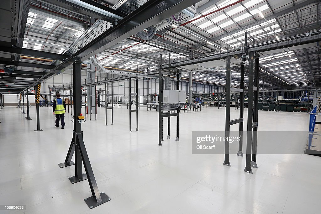 A worker walks in the giant semi-automated distribution centre where the company's partners process the online orders for the John Lewis department store on January 3, 2013 in Milton Keynes, England. John Lewis has published their sales report for the five weeks prior December 29, 2012 which showed online sales had increased by 44.3 per cent over the same period in 2011. Purchases from their website Johnlewis.com now account for one quarter of all John Lewis business.