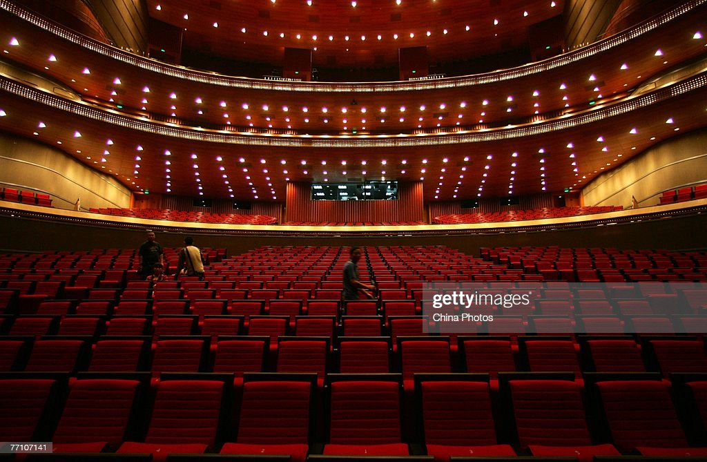 A worker walks in the opera house of National Grand Theater on September 29 2007 in Beijing China The National Grand Theatre staged its trial...