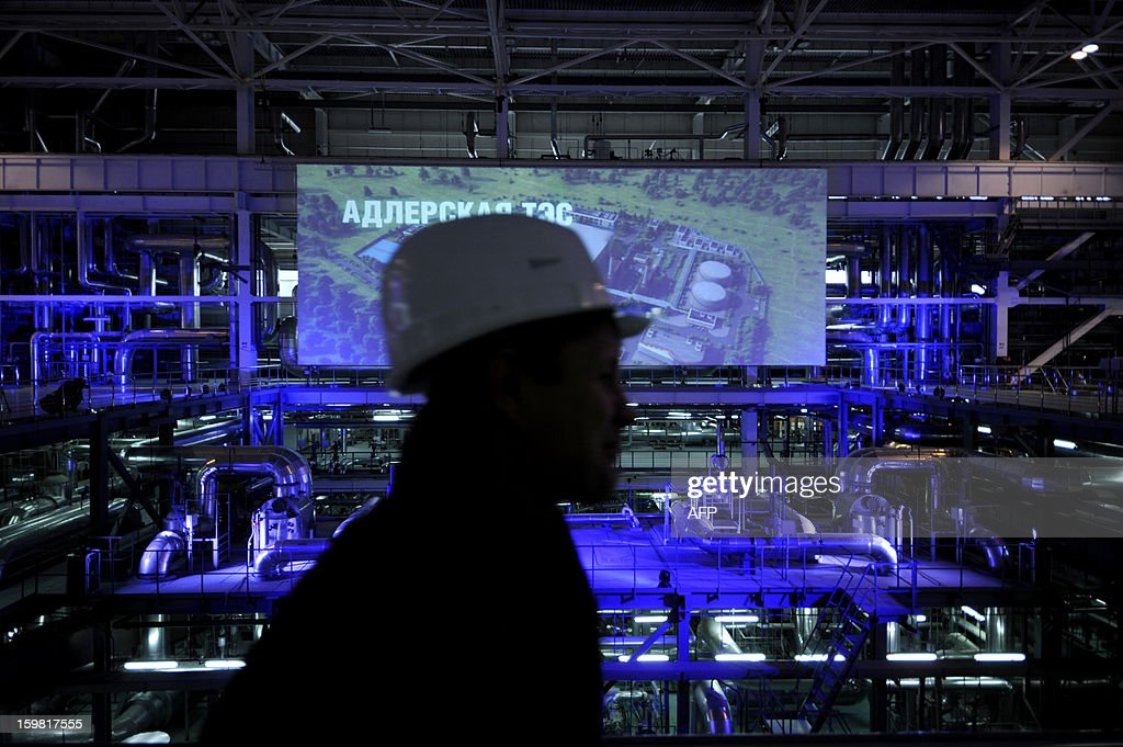 A worker walks inside the recently built Adler thermal power plant in the Russian Black Sea resort of Sochi, on January 21, 2013. The 360 MW Adler thermal power plant will be one of the main sources of power for the coastal cluster of the Sochi 2014 Olympic venues.
