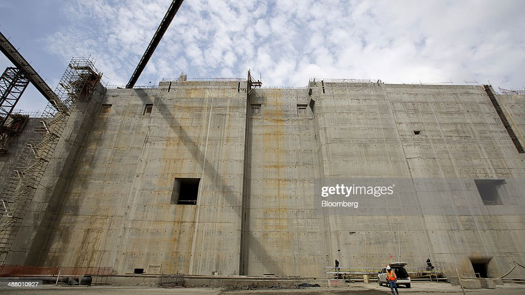 A worker walks near a concrete wall at the construction site for the third sets of locks on the Pacific side of the Panama Canal near Panama City, Panama, on Thursday, April 24, 2014. Panama's presidential contenders are winding down their campaigns ahead of the May 4 election as a strike by construction workers paralyzes the expansion of the country's signature waterway, its biggest economic resource. Photographer: Susana Gonzalez/Bloomberg via Getty Images
