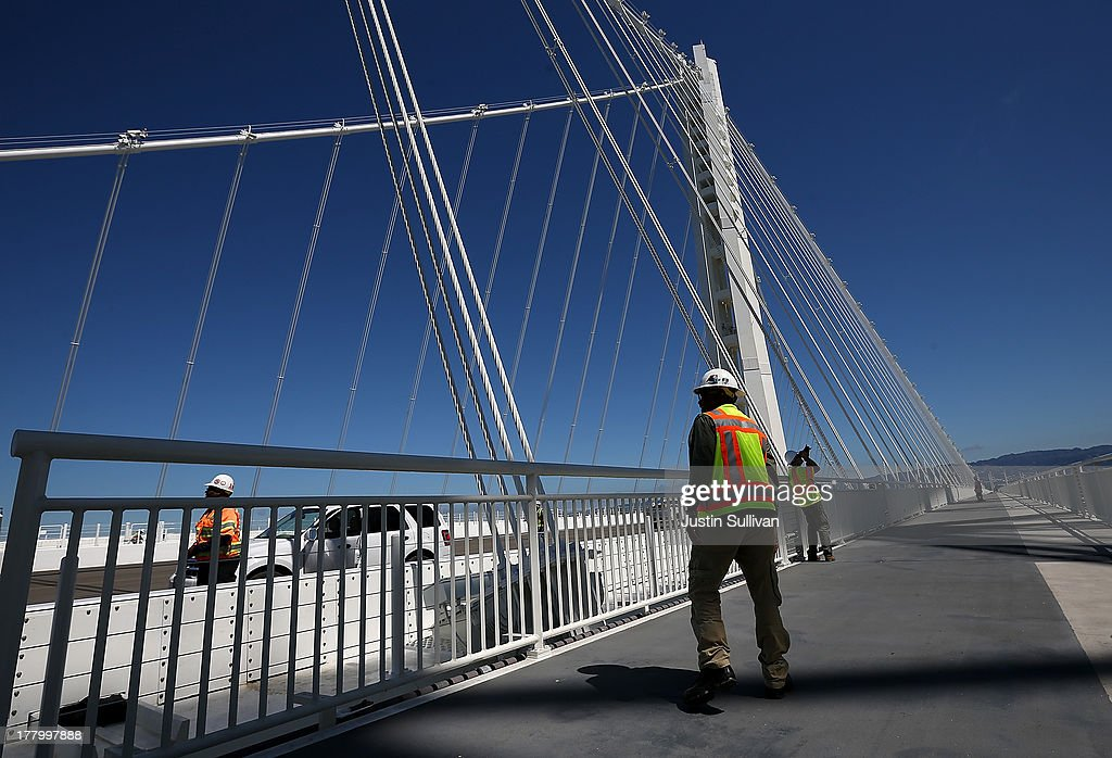 A worker walks on the bike path next to the new Bay Bridge Self-Anchored Suspension (SAS) tower on August 26, 2013 in San Francisco, California. After nearly 12 years of construction and an estimated price tag of $6.4 billion, the new eastern span of the Bay Bridge is set to open on September 3. The bridge will be the world's tallest Self-Anchored Suspension (SAS) tower once completed.