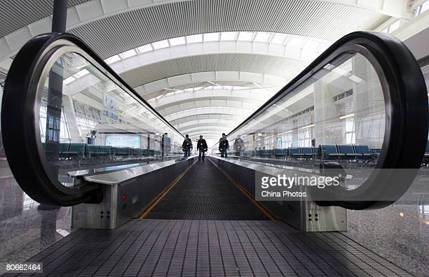 A worker walks on the conveyor belt for passengers in the No 2 Terminal Building of Wuhan Tianhe Airport on April 13 2008 in Wuhan of Hubei Province...