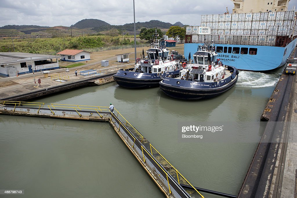 A worker walks on the Miraflores Locks after the Maersk container ship Bali is guided through at the Panama Canal near Panama City, Panama, on Wednesday, April, 23, 2014. Construction projects throughout Panama have remained idle since April 23, when workers walked off the job in an effort to win a 35 percent salary increase. The strike threatens to further delay the canals expansion, designed to accommodate larger ships and help reduce transport costs for commodities such as liquefied natural gas. Photographer: Susana Gonzalez/Bloomberg via Getty Images