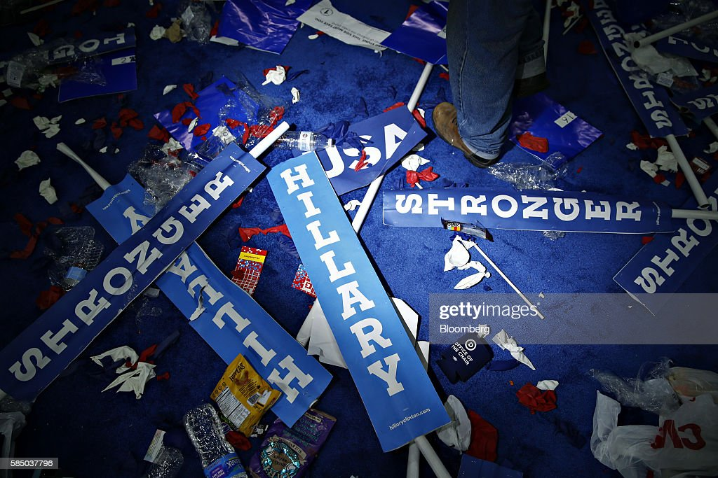 A worker walks past a 'Hillary' sign on the floor after the Democratic National Convention (DNC) in Philadelphia, Pennsylvania, U.S., on Thursday, July 28, 2016. Division among Democrats has been overcome through speeches from two presidents, another first lady and a vice-president, who raised the stakes for their candidate by warning that her opponent posed an unprecedented threat to American diplomacy. Photographer: Andrew Harrer/Bloomberg via Getty Images