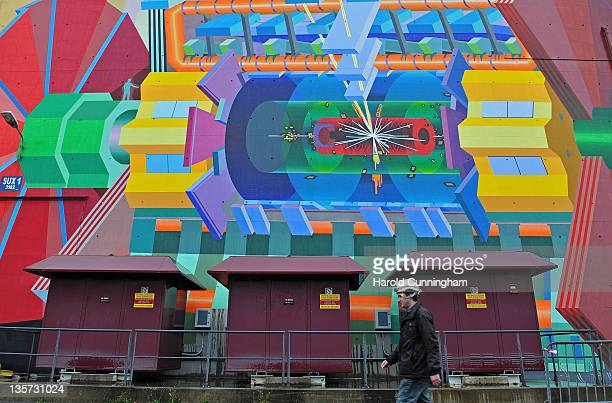 CERN worker walks past a painted representation of the ATLAS LHC on December 13 2011 in Geneva Switzerland The European Organization for Nuclear...