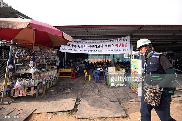 A worker walks past a restaurant located opposite the Samsung Electronics Vietnam Co Plant at Yen Phong Industrial Park in Bac Ninh Province Vietnam...