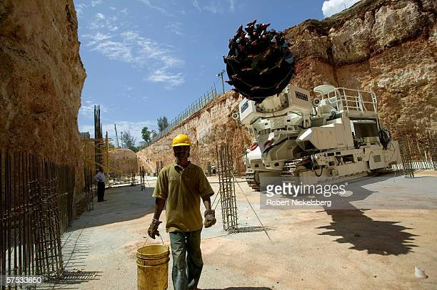 A worker walks past a tunnel boring machine during construction of a 14 km metro system on April 3 2006 in Santo Domingo Dominican Republic The first...
