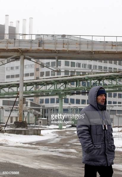 Worker walks past at Chernobyl nuclear power plant in Chernobyl Ukraine on December 22 2016 The Chernobyl accident occurred on 26 April 1986 at the...