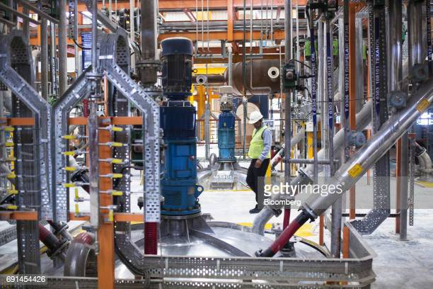 A worker walks past paint mixing hoppers at an Akzo Nobel India Ltd factory in Gwalior Madhya Pradesh India on Thursday June 1 2017 Akzo Nobel NV...