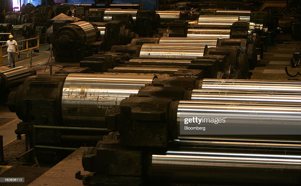 A worker walks past steel rollers in the roll shop area of the PT Krakatau Steel plant in Cilegon, Banten province, Indonesia, on Thursday, Feb. 21, 2013. Krakatau Steel is Indonesia's biggest maker of the metal. Photographer: Dadang Tri/Bloomberg via Getty Images