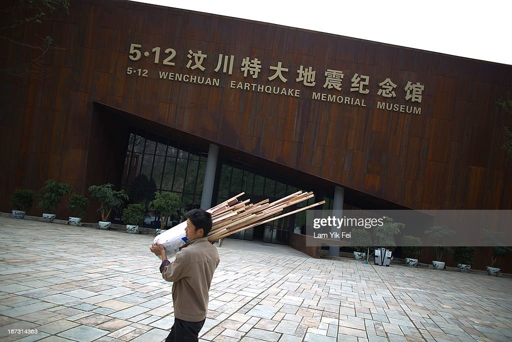 A worker walks past the 5.12 Wenchuan Earthquake Memorial Museum at Beichuan town in Sichuan province on April 24, 2013 in Chengdu, China. The Beichuan earthquake memorial was built in memory of the over 70,000 that perished in the deadly 2008 quake that struck Sichuan province and was built near the Beichuan Middle School, where over 1,000 students and teachers died. With the five year quake anniversary only a few weeks away, residents of Sichuan province are coming to grips with the April 20 earthquake in nearby Ya'An that claimed the lives of over 190 people and injured thousands.