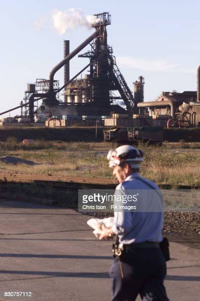 A worker walks past the Corus steelworks in Port Talbot South Wales after a man was killed last night in an explosion in blast furnace 5 13 others...