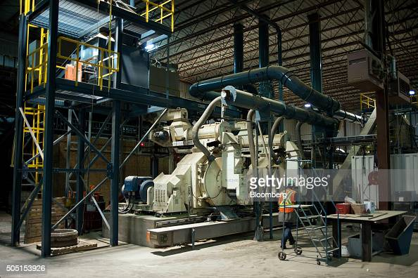 A worker walks past the wood pellet machine at the Resolute Forest Products mill in Thunder Bay Canada Ontario on Friday Jan 8 2016 Resolute Forest...
