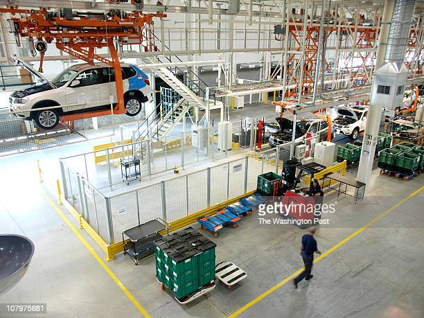 A worker walks the floor of the new Assembly North plant at the BMW plant in Greer SC Tuesday October 19 2010 The BMW X3 Sport Activity Vehicle is...