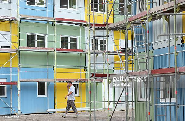 A worker walks through a container facility under construction in Zehlendorf district that will house refugees and asylum applicants on July 9 2015...