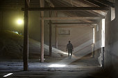 A worker walks through a warehouse of stored wheat grain at a storage depot operated by Kuban Agroholding a unit of Basic Element Co in UstLabinsk...