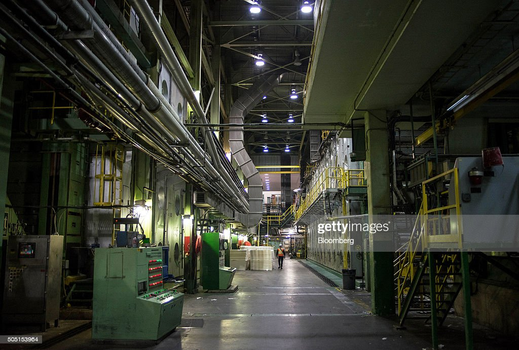A worker walks through the secondary paper manufacturing wing at the Resolute Forest Products mill in Thunder Bay Canada Ontario on Thursday Jan 7...