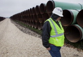 A worker walks through the TransCanada Corp Houston Lateral Project pipe yard in Mont Belvieu Texas US on Wednesday March 5 2014 Russ Girling...