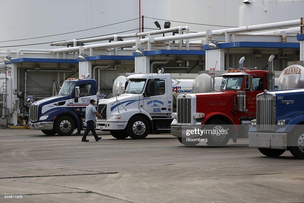 A worker walks towards oil trucks at the PBF Energy Inc Toledo Refining Company facility in Oregon Ohio US on Thursday June 30 2016 PBF Energy an...