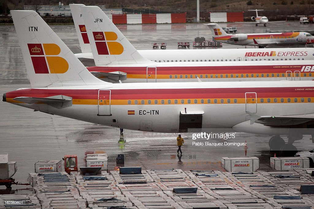 A worker walks under an Iberia plane at Barajas Airport on February 22, 2013 in Madrid, Spain. Today is the last of a five day strike held by Iberia cabin crew, maintenance workers and ground staff in response to the planned loss of 3,800 jobs. The strike has resulted in the airline having to cancel 400 flights this week with unions planning more five day strikes in the following weeks.