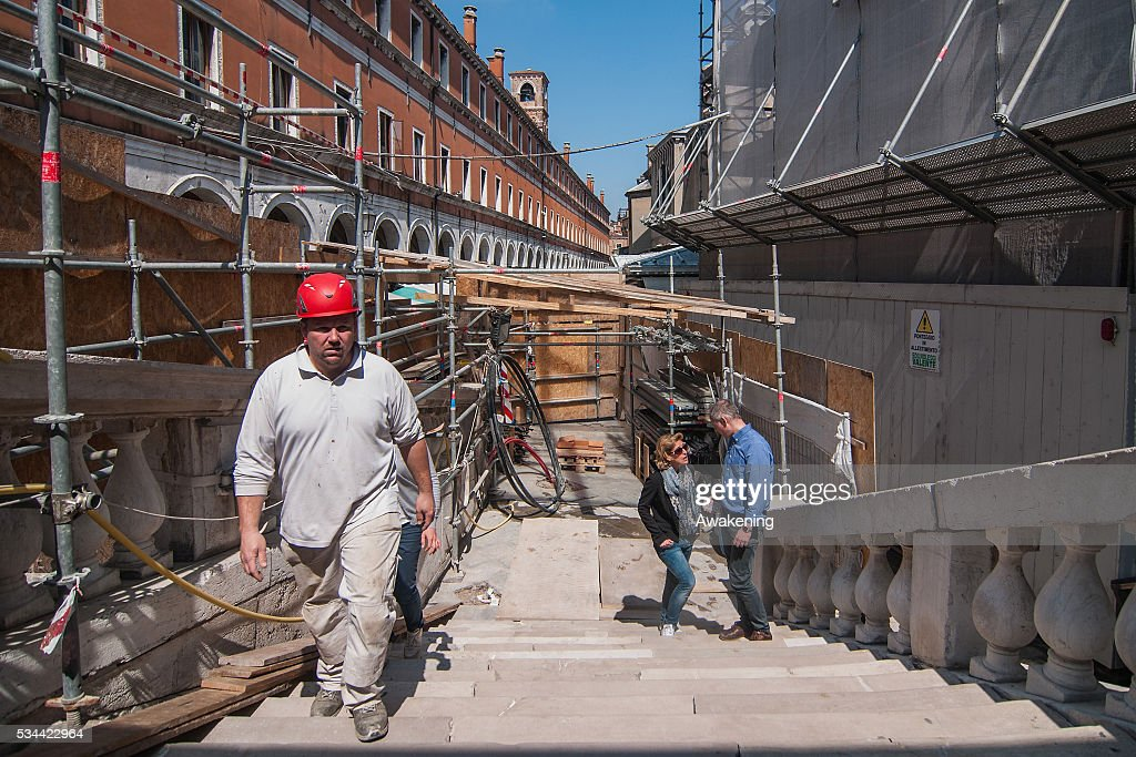A worker walks up the stairs during the renovation of the Rialto Bridge on May 26, 2016 in Venice, Italy. Site visits were organized to see the renovation of the Rialto bridge to coincide with the 15th Biennale of Architecture in Venice.