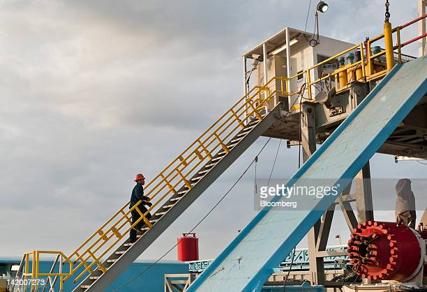 A worker walks up to the floor of Orion Drilling Co's Perseus drilling rig near Encinal in Webb County Texas US on Monday March 26 2012 The Perseus...
