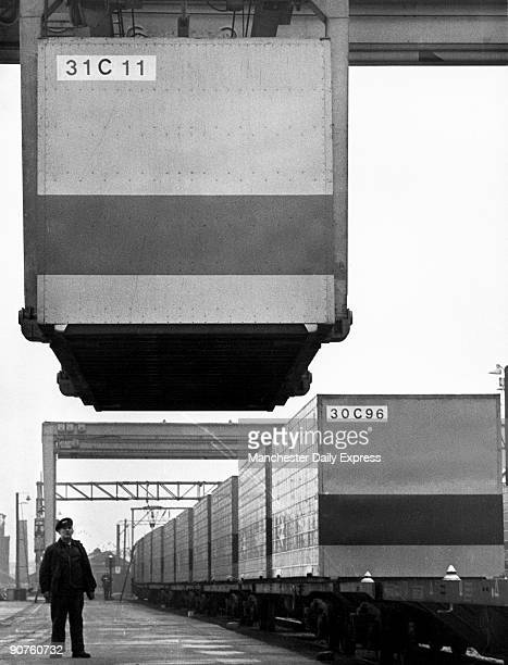 A worker watches as a container is loaded onto the new liner service