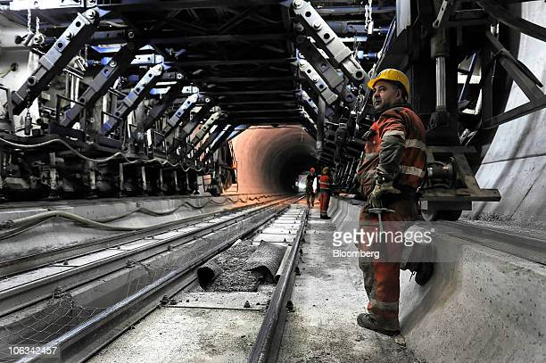 A worker watches construction in the Gotthard railway tunnel in Erstfeld Switzerland on Wednesday Oct 27 2010 When completed the tunnel will be the...